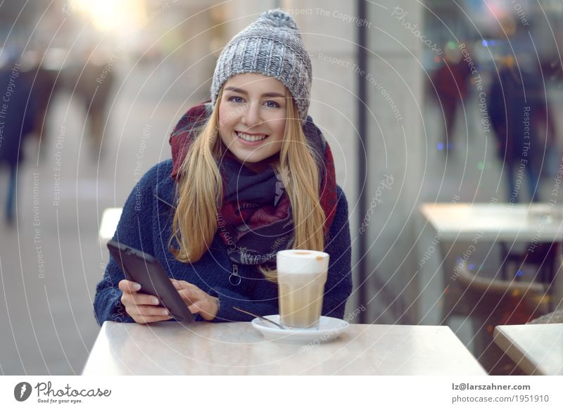 Young blond woman with mobile drinking coffee Human being Woman Youth (Young adults) Beautiful Winter 18 - 30 years Face Adults Street Lifestyle Happy