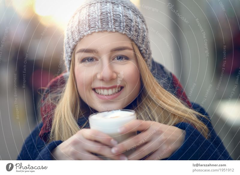 Young blond woman drinking big glass of coffee Nutrition Drinking Coffee Latte macchiato Lifestyle Happy Beautiful Face Winter Woman Adults 1 Human being