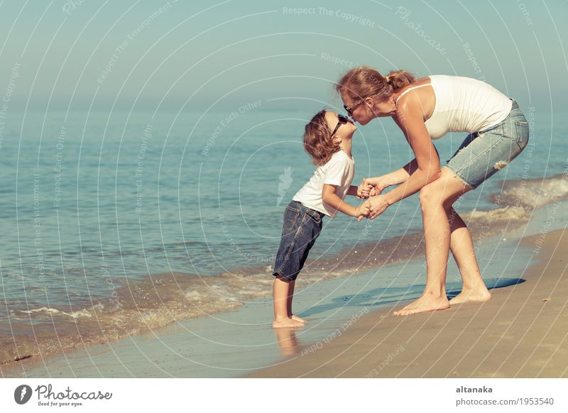 Mother and son playing on the beach at the day time. Lifestyle Joy Relaxation Leisure and hobbies Playing Vacation & Travel Trip Freedom Summer Sun Beach Ocean