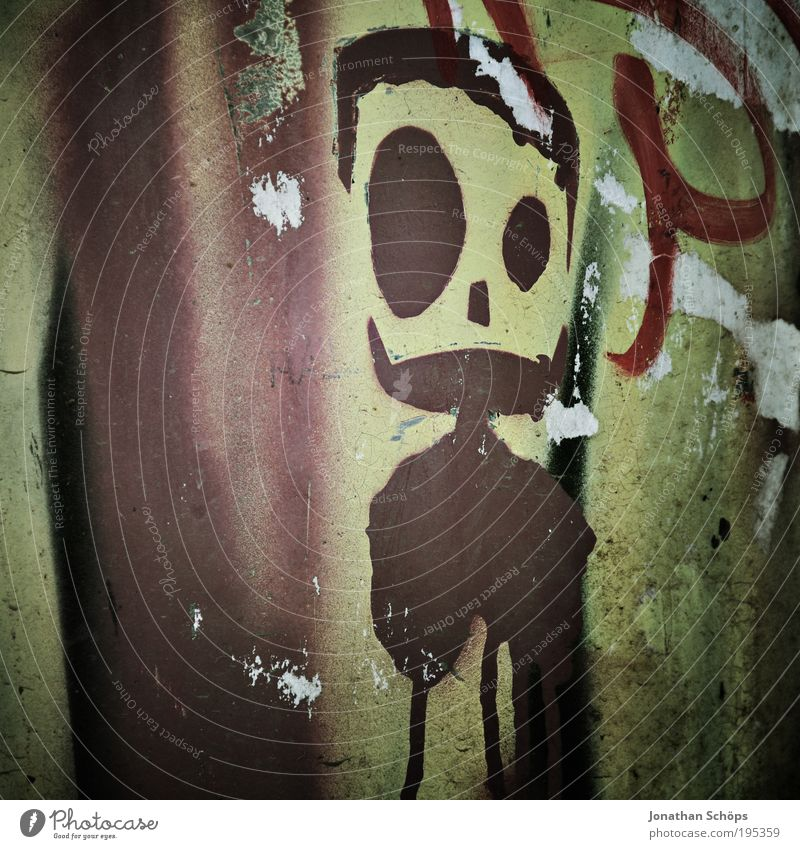 Wall (building) Style Graffiti Wall (barrier) Brown Design Uniqueness Figure Graphic Street art Subculture Youth culture Smeared Comic strip character