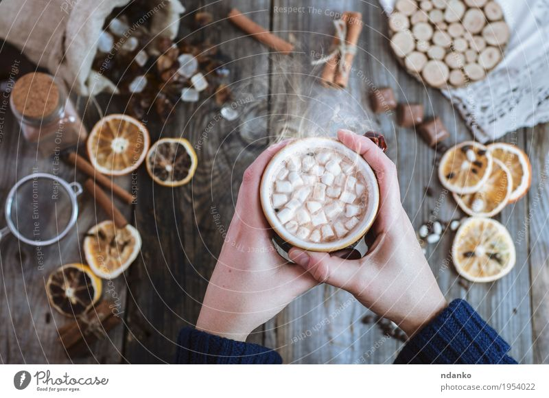 Women's hands are holding a cup of hot drink Fruit Dessert Candy Breakfast To have a coffee Beverage Hot Chocolate Coffee Cup Mug Decoration Table Woman Adults