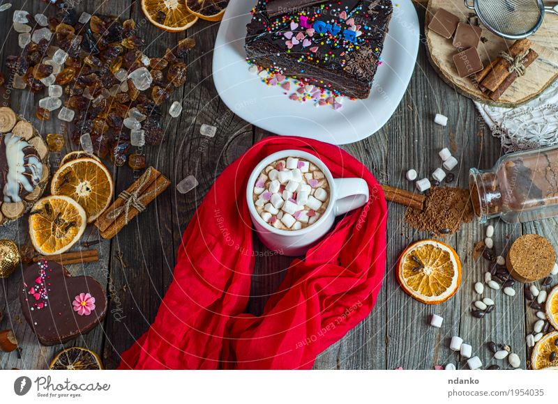 cup of chocolate drink with marshmallows wrapped in red scarf White Red Eating Wood Food Gray Brown Above Table Herbs and spices Beverage Coffee Delicious Candy Cake Dessert