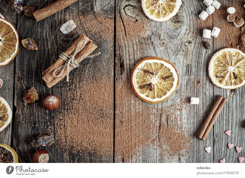 Abstract gray wooden background with spices and dried fruit Old Wood Food Gray Brown Orange Retro Table Herbs and spices Kitchen Tradition Home Crack & Rip & Tear Baked goods Top Sugar
