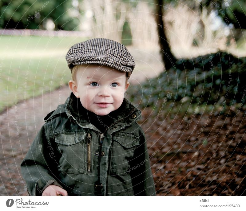 Finally playing outside again Contentment Children's game Human being Toddler Boy (child) Infancy Face 1 1 - 3 years Nature Tree Leaf Park Hat Cap Blonde