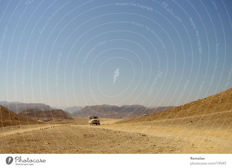 Jeep in the desert of Sinai (1) Offroad vehicle Contentment jeep Desert Stone Sky Sand Far-off places Freedom