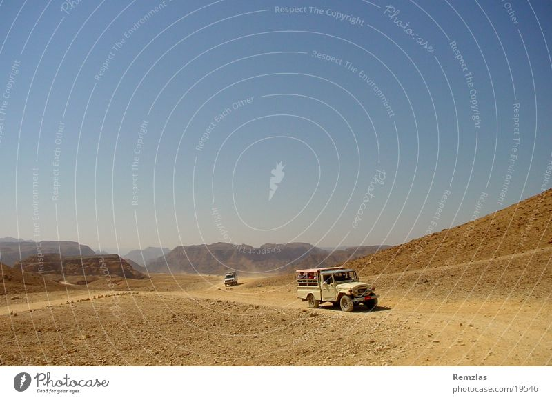 Jeep in the Sinai Desert (2) Offroad vehicle Contentment jeep Stone Sky Sand Far-off places Freedom