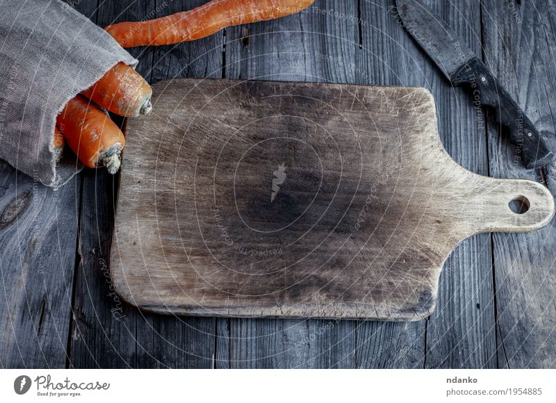 Empty cutting board with a kitchen knife Vegetable Eating Vegetarian diet Knives Table Wood Diet Old Fresh Delicious Natural Above Gray Orange Organic Top