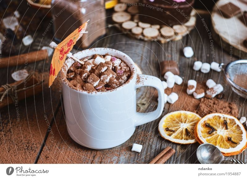 cup of hot chocolate with marshmallows sprinkled Winter Natural Wood Gray Brown Above Orange Fruit Table To enjoy Beverage Coffee Hot Breakfast Dessert Top