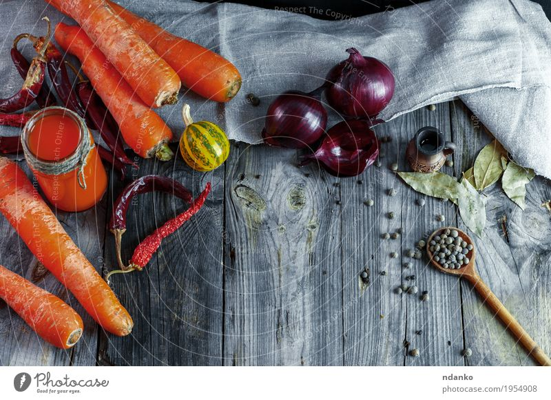 Ripe fresh orange carrots with fresh juice Vegetable Herbs and spices Eating Vegetarian diet Diet Drinking Juice Bottle Spoon Table Kitchen Restaurant Container