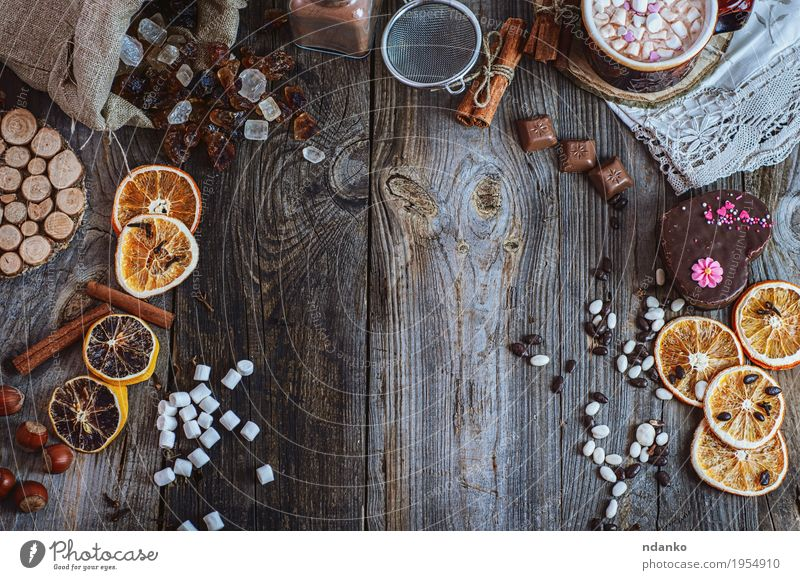 Kitchen table with sweets and dessert, top view Orange Cake Dessert Candy Chocolate Herbs and spices Eating Beverage Hot Chocolate Cup Sieve Wood Old Make Above