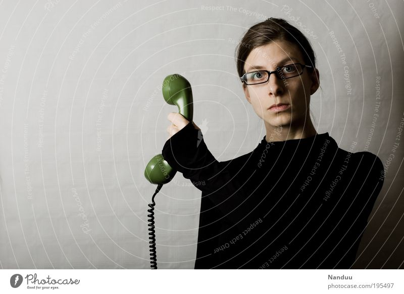 Hold on, I'll connect you. Human being Feminine Young woman Youth (Young adults) 1 Nerdy Petit bourgeois Person wearing glasses Clerk Telephone