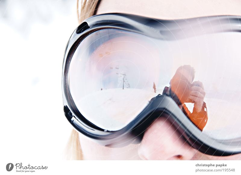 Snow Goggles Winter Winter vacation Mountain Ski run Young woman Youth (Young adults) Brixental Austria Ski lift Sports Athletic Leisure and hobbies