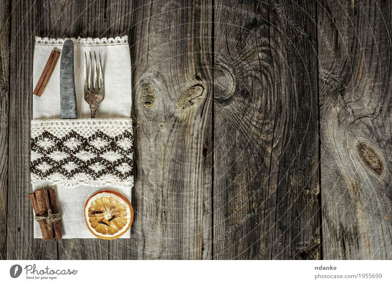 Metal utensils decorated with a napkin on a gray wooden surface Old White Wood Gray Above Retro Vantage point Table Kitchen Restaurant Steel Crack & Rip & Tear