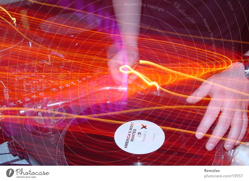 Amarican´s most wanted? Disc jockey Hand Turntable Light Long exposure Human being Music