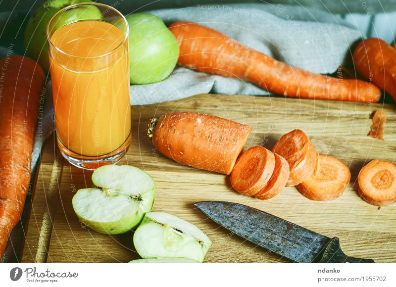 glass of fresh juice of carrots and apples with fresh vegetables Green Eating Autumn Wood Health care Gray Orange Fruit Nutrition Glass Retro Glass Kitchen Drinking Vegetable Cloth