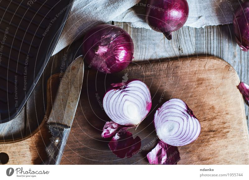 Cut in half red onion on a chopping board Vegetable Vegetarian diet Pan Knives Kitchen Cloth Wood Metal Old Dark Fresh Above Retro Brown Gray Red Black Onion