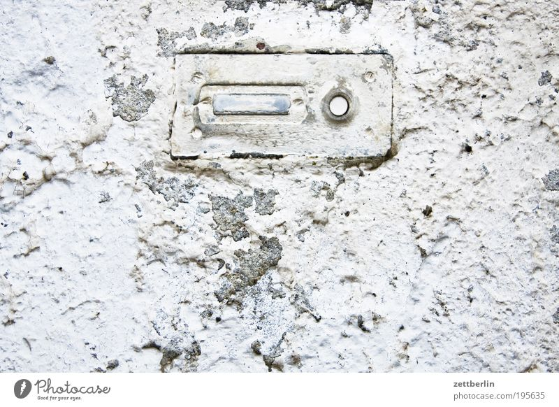 Nobody here. Bell Name plate Visitor Anonymous White Lime Plaster Rough roughcast Surface Structures and shapes Arrangement Buttons Signal Information