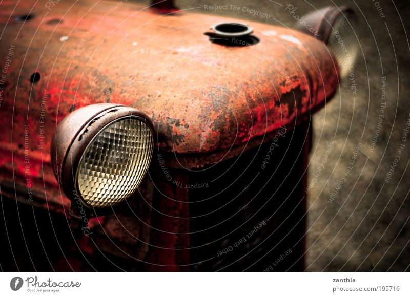 old eyes Vehicle Tractor Old Looking Wait Dirty Broken Original Round Brown Gray Red Patient Calm Movement Loneliness End Apocalyptic sentiment Stagnating