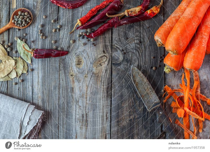 Carrot, chili and spices on gray wooden surface Old Red Eating Natural Food Health care Gray Orange Nutrition Fresh Table Herbs and spices Vegetable Knives Top