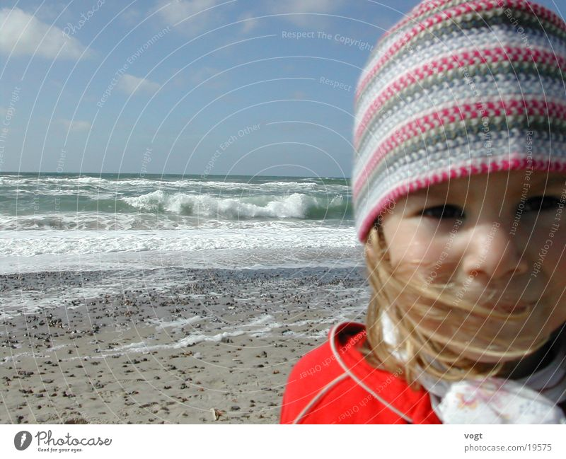 Child Ocean Beach Clouds Face Eyes Happy Hair and hairstyles Sand Waves Wind Cap Denmark