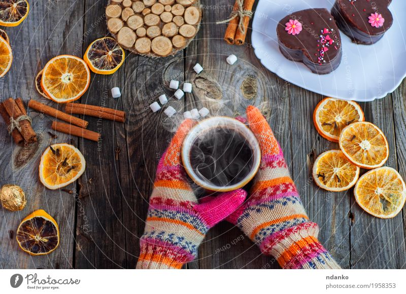 cup of black hot coffee in her hands Human being Woman Youth (Young adults) Christmas & Advent Hand Winter 18 - 30 years Adults Eating Wood Food Gray Brown Above Orange Fruit