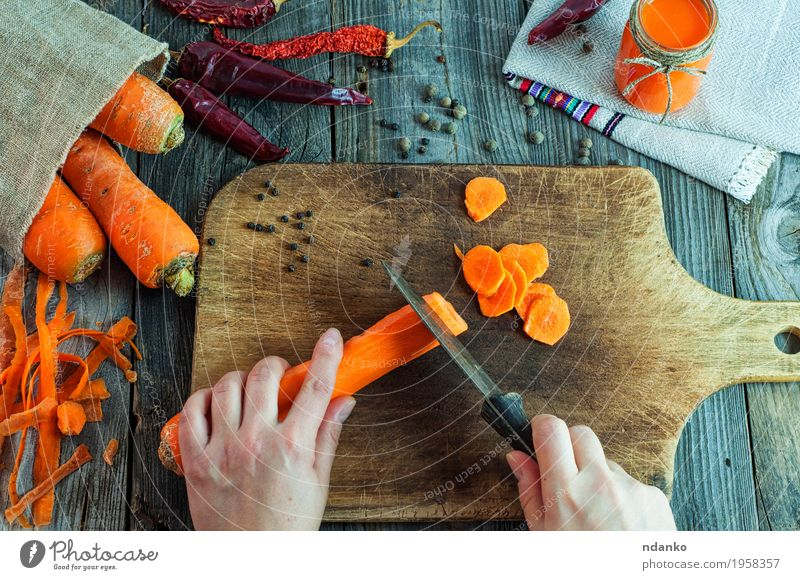 process of cutting slices of fresh carrots Human being Woman Youth (Young adults) Old Healthy Eating Hand Red 18 - 30 years Adults Natural Wood Food Health care