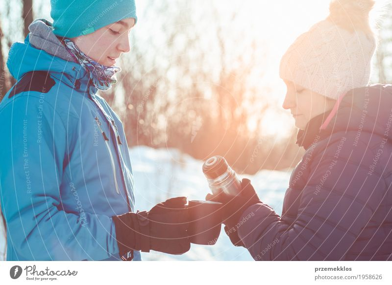 Break for hot drink during the winter trip Human being Woman Nature Vacation & Travel Youth (Young adults) Man Blue Joy Winter Forest Adults Lifestyle Snow