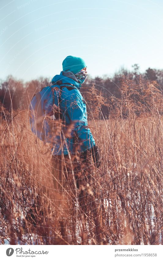 Boy hiking through meadows in the wintertime Human being Nature Vacation & Travel Youth (Young adults) Landscape Loneliness Joy Winter Lifestyle Meadow Snow Sports Grass Boy (child) Freedom Trip