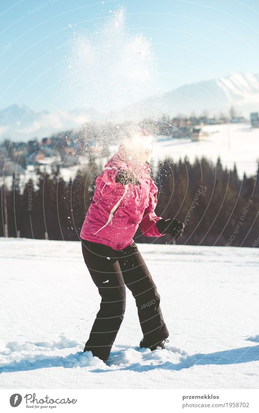 Woman throwing the snow in the air Human being Nature Vacation & Travel Joy Winter Mountain Adults Lifestyle Funny Snow Trip Happiness To enjoy Cool (slang)