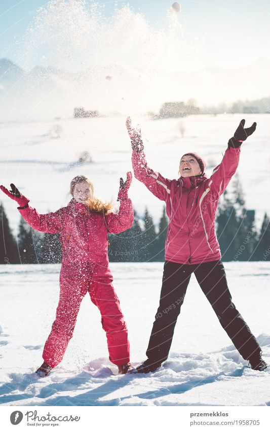 Mother enjoying the snow with her daughter outdoors Lifestyle Joy Happy Winter Snow Winter vacation Human being Girl Woman Adults Parents Family & Relations