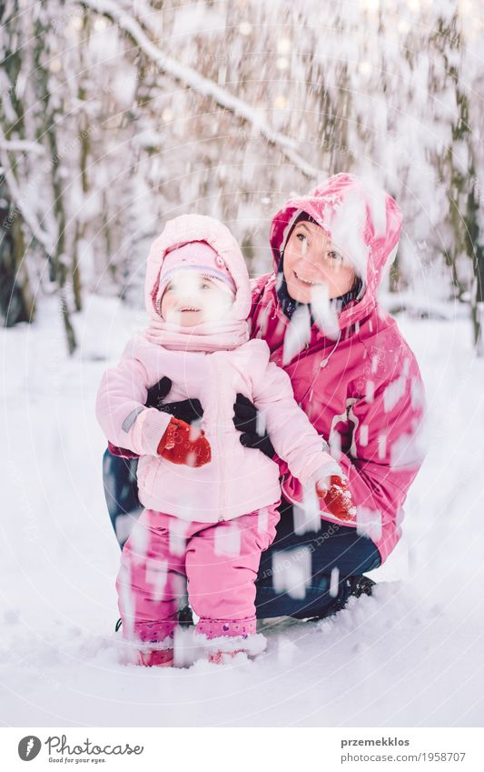 Mother spending time with her little daughter outdoors Lifestyle Joy Happy Leisure and hobbies Playing Trip Winter Snow Child Human being Baby Girl Woman Adults