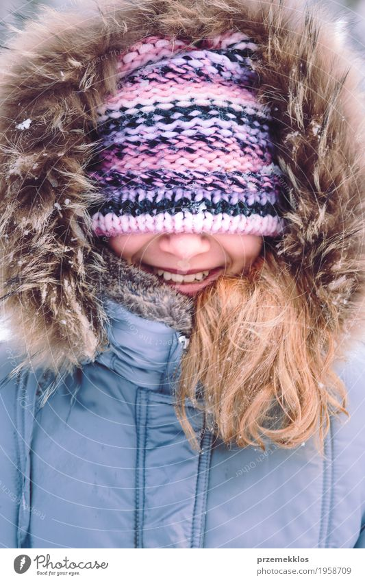 Portrait of girl with covered face with her hat outdoors Lifestyle Joy Happy Winter Snow Girl Woman Adults 1 Human being 8 - 13 years Child Infancy Hat To enjoy
