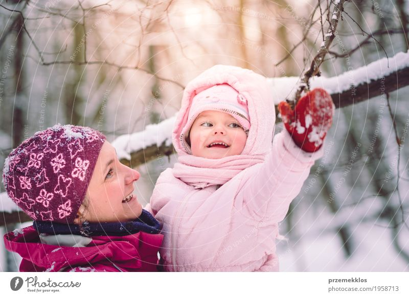 Mother spending time with her little daughter outdoors Lifestyle Joy Happy Leisure and hobbies Winter Snow Child Human being Baby Girl Woman Adults Parents