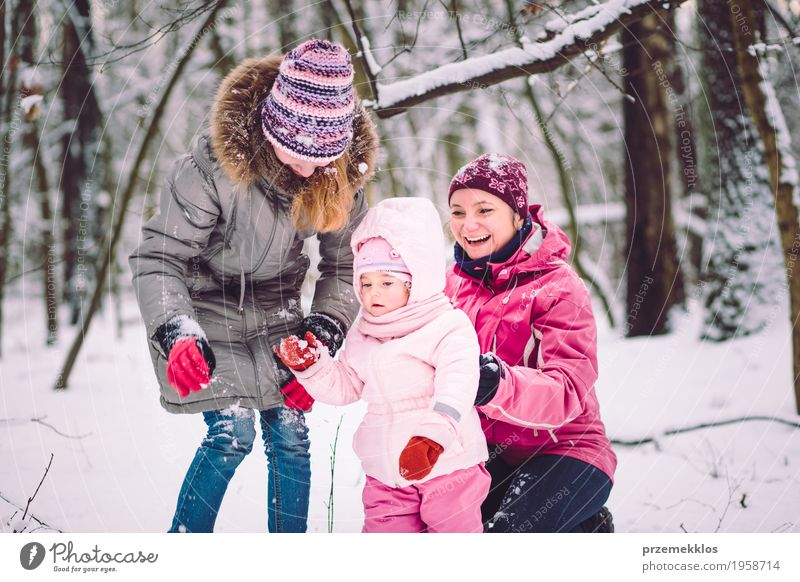 Mother spending time with her children outdoors Lifestyle Joy Happy Leisure and hobbies Playing Winter Snow Child Human being Baby Girl Woman Adults Parents