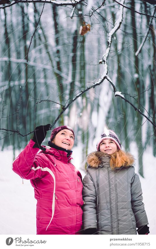 Mother and daughter during the walk in the forest Lifestyle Joy Trip Winter Snow Winter vacation Human being Girl Woman Adults Parents Family & Relations 2