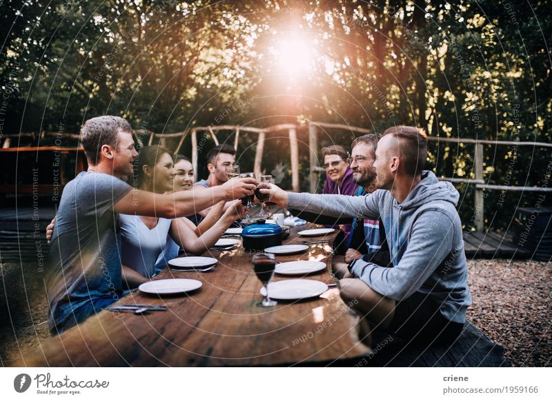 Family toasting with wine glasses at outdoor dinner Nature Eating Family & Relations Garden Food Group Together Friendship Glass Happiness Smiling Friendliness Beverage Drinking Wine Crockery