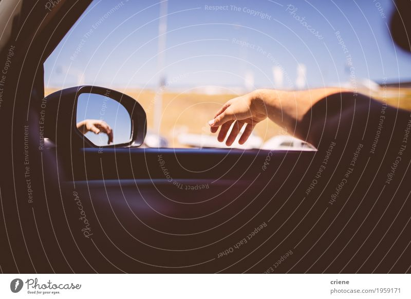 Man leaning hand out of car window on roadtrip Vacation & Travel Man Summer Hand Joy Far-off places Adults Lifestyle Freedom Transport Trip Car Happiness To enjoy Adventure Wanderlust