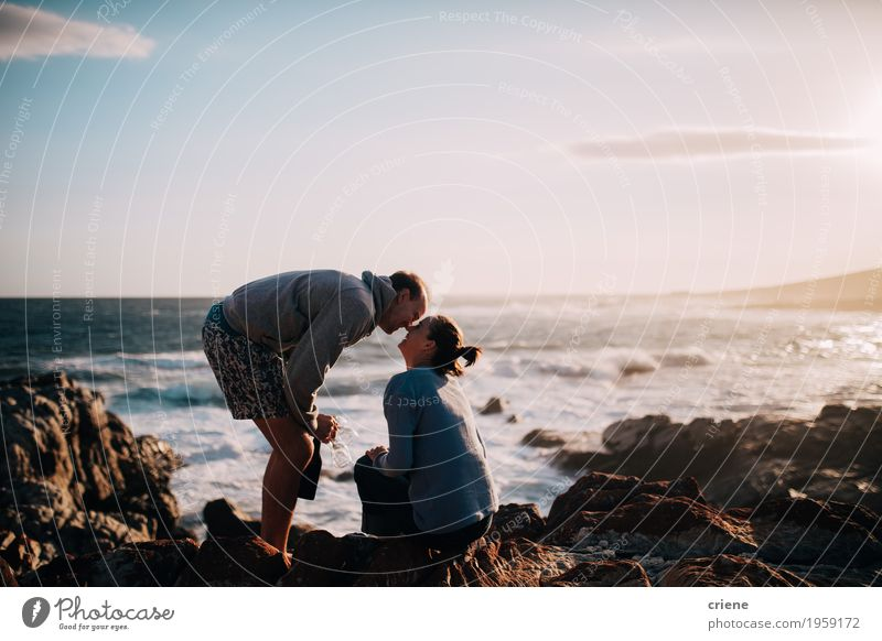 Young adult caucasian couple kissing on cliff at ocean Human being Vacation & Travel Youth (Young adults) Young woman Young man Ocean Joy Beach Adults Love Lifestyle Couple Tourism Together Trip Happiness
