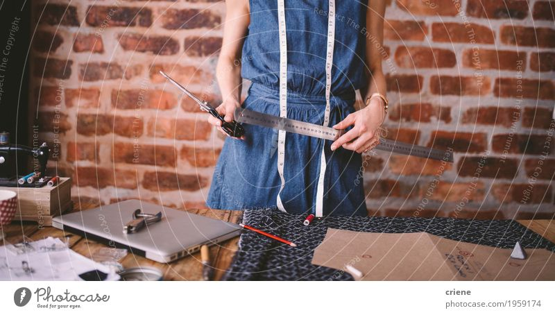 Young female fashion designer holding tools in her hands Youth (Young adults) Young woman Fashion Design Work and employment Leisure and hobbies Creativity Profession Material Make Notebook Self-made Measure Creation SME Caucasian