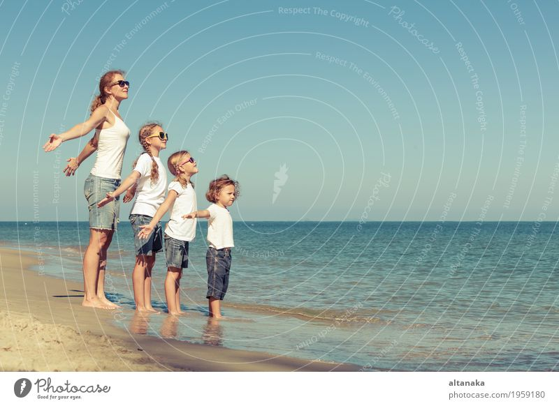 Mother and children playing on the beach. Lifestyle Joy Relaxation Leisure and hobbies Playing Vacation & Travel Trip Freedom Summer Sun Beach Ocean Child