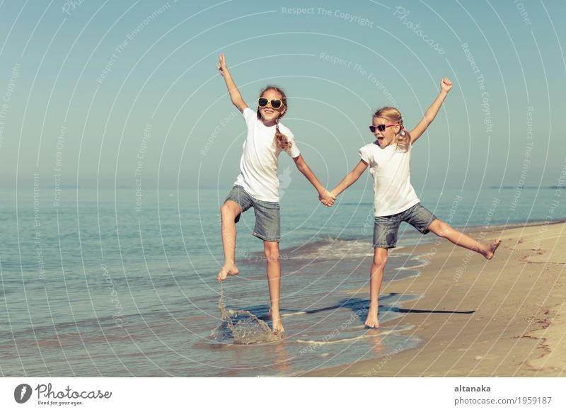 two sisters playing on the beach Lifestyle Joy Happy Beautiful Relaxation Leisure and hobbies Playing Vacation & Travel Freedom Summer Sun Beach Ocean Success