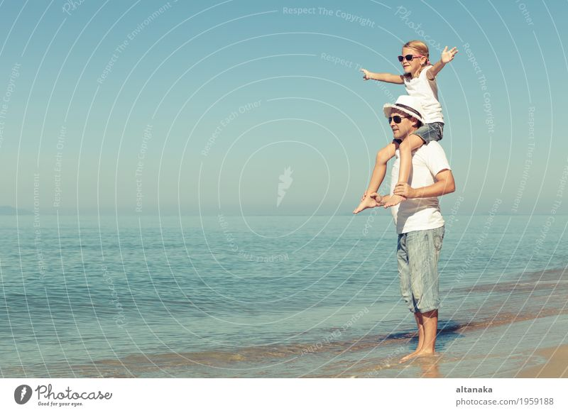 Father and daughter playing on the beach at the day time. Child Woman Nature Vacation & Travel Summer Sun Hand Ocean Relaxation Joy Girl Beach Adults Life Love