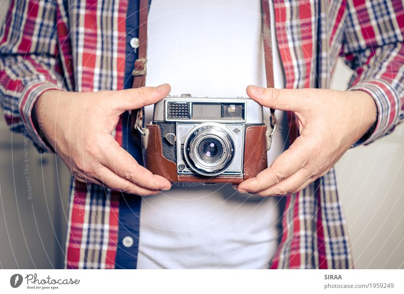 old camera Camera Masculine Man Adults Hand 1 Human being 45 - 60 years T-shirt Shirt To hold on Old Ancient Antique Retro Colour photo Interior shot Close-up