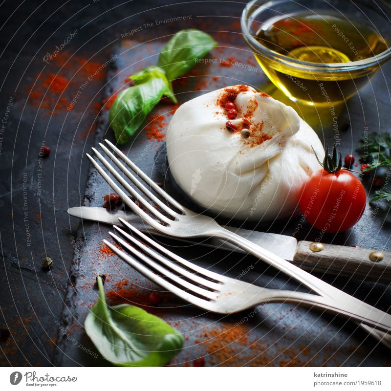 Italian cheese burrata, tomatoes, basil and olive oil Cheese Dairy Products Vegetable Herbs and spices Cooking oil Nutrition Vegetarian diet Italian Food Fork