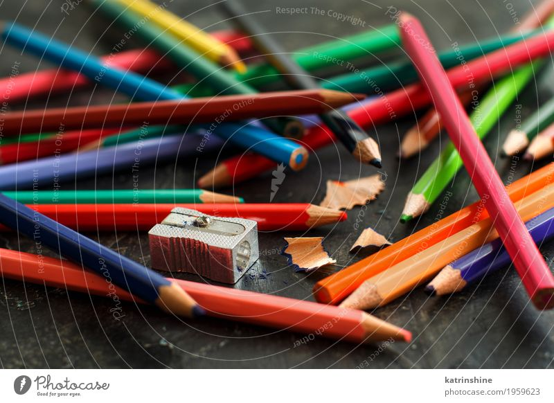 A sharpener and color pencils Blue Colour Green White Red Dark Yellow Wood School Design Pink Bright Leisure and hobbies Creativity Handcrafts Communication