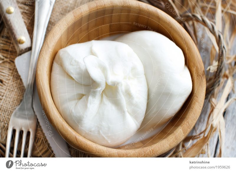 Italian cheese burrata Cheese Dairy Products Nutrition Vegetarian diet Bowl Fork Wood Fresh Delicious Soft White appetizer Apulia background cream Creamy