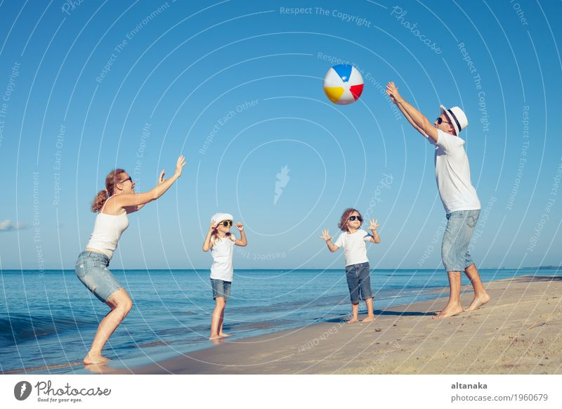 Happy family playing on the beach at the day time. Lifestyle Joy Relaxation Leisure and hobbies Playing Vacation & Travel Trip Freedom Summer Sun Beach Ocean