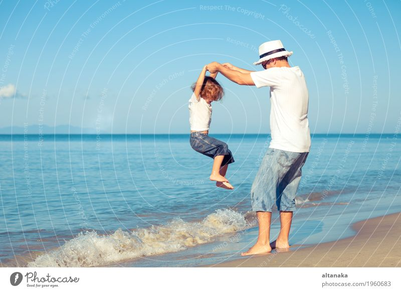 Father and son playing on the beach at the day time. Lifestyle Joy Relaxation Leisure and hobbies Playing Vacation & Travel Trip Adventure Freedom Summer Sun