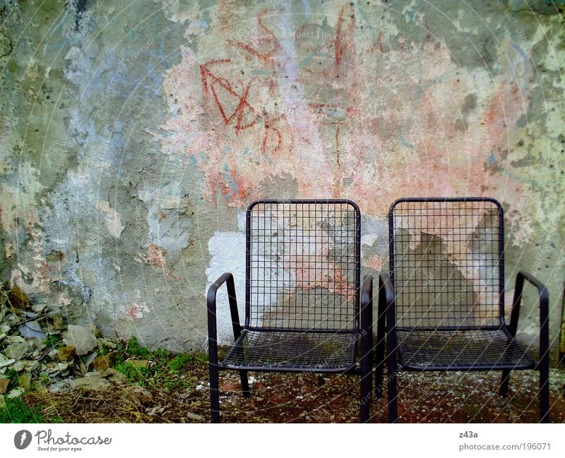 My place in the sun Garden Chair Deserted Wall (barrier) Wall (building) Facade Terrace Garden chair Concrete Old Dirty Dark Cold Financial Industry Fiasco