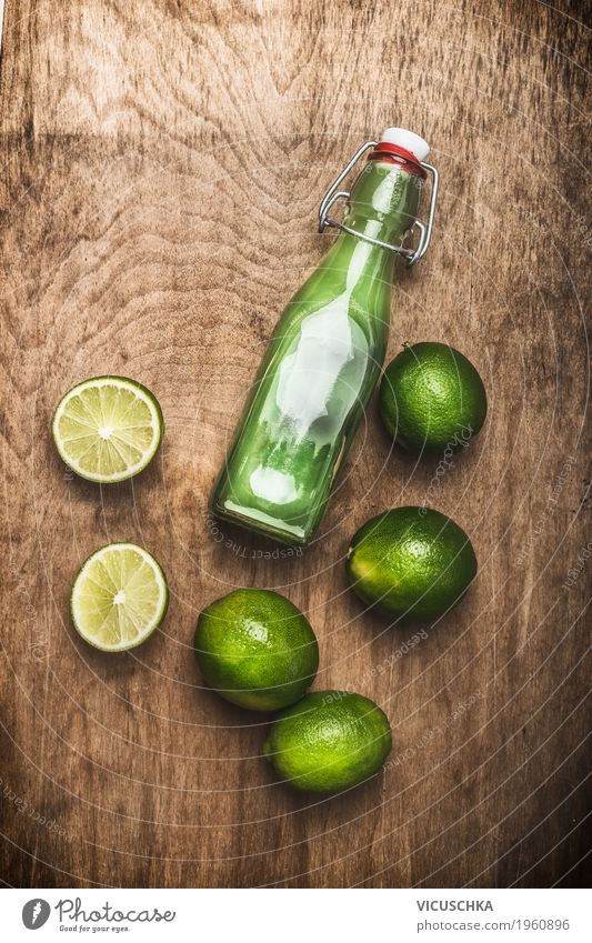 Bottle with lime juice Food Fruit Organic produce Vegetarian diet Diet Beverage Juice Style Design Healthy Healthy Eating Life Summer Table Restaurant Bar
